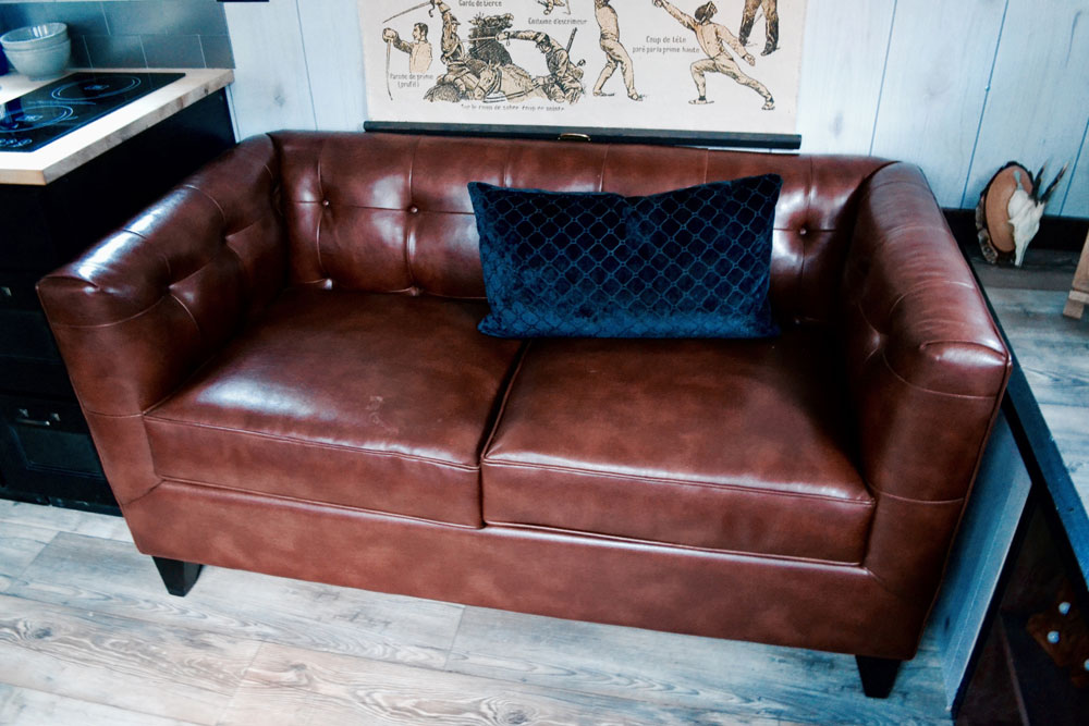 Leather couch - Aerodynamic by Tiny Heirloom
