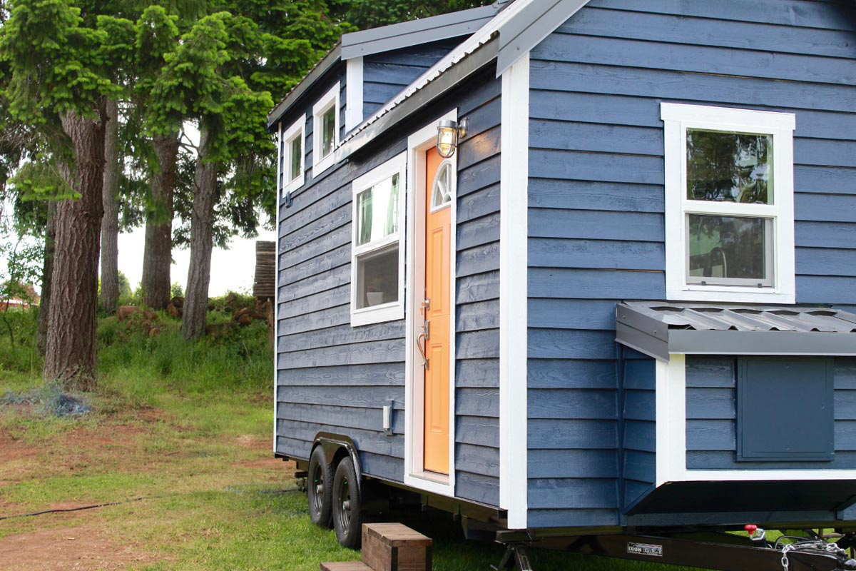 Pretty blue exterior and white trim - Craftsman by Tiny Heirloom