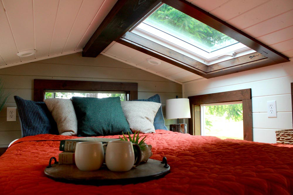 Bedroom loft with king bed and skylight - Craftsman by Tiny Heirloom