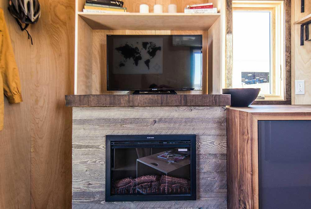 Entertainment center with electric fireplace - Farallon by Tumbleweed Tiny House Company