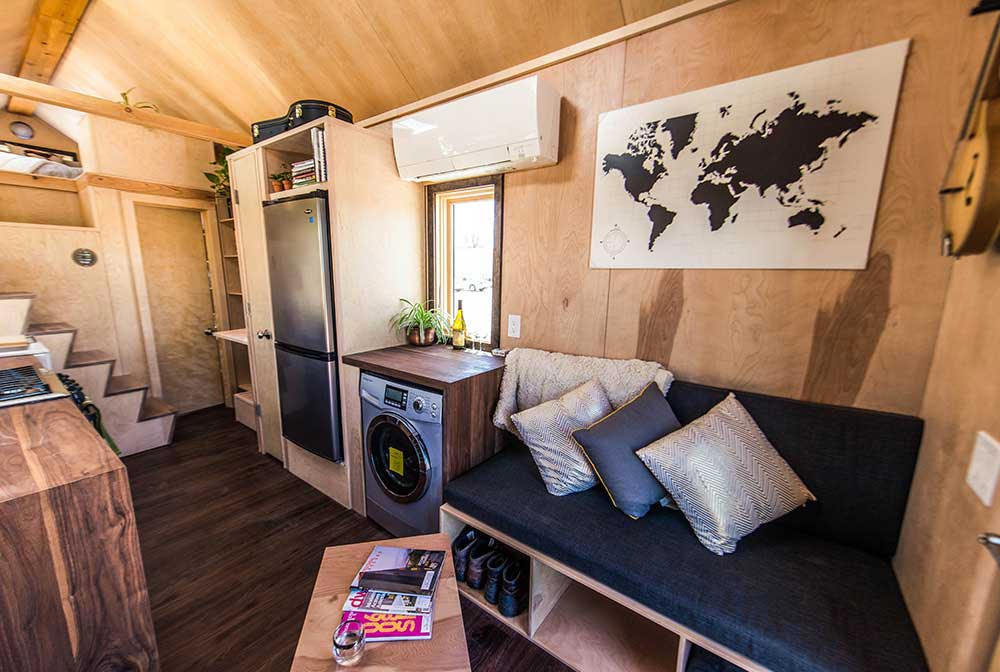 Custom couch with storage and hidden coffee table - Farallon by Tumbleweed Tiny House Company