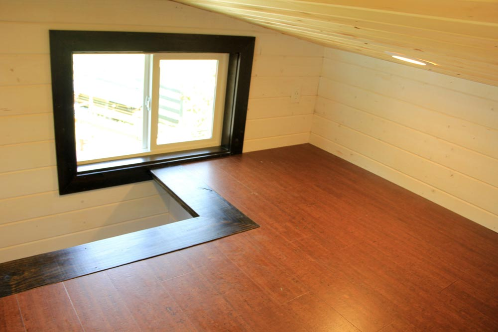 Main loft with stair access in back - Fort Austin by Brevard Tiny House