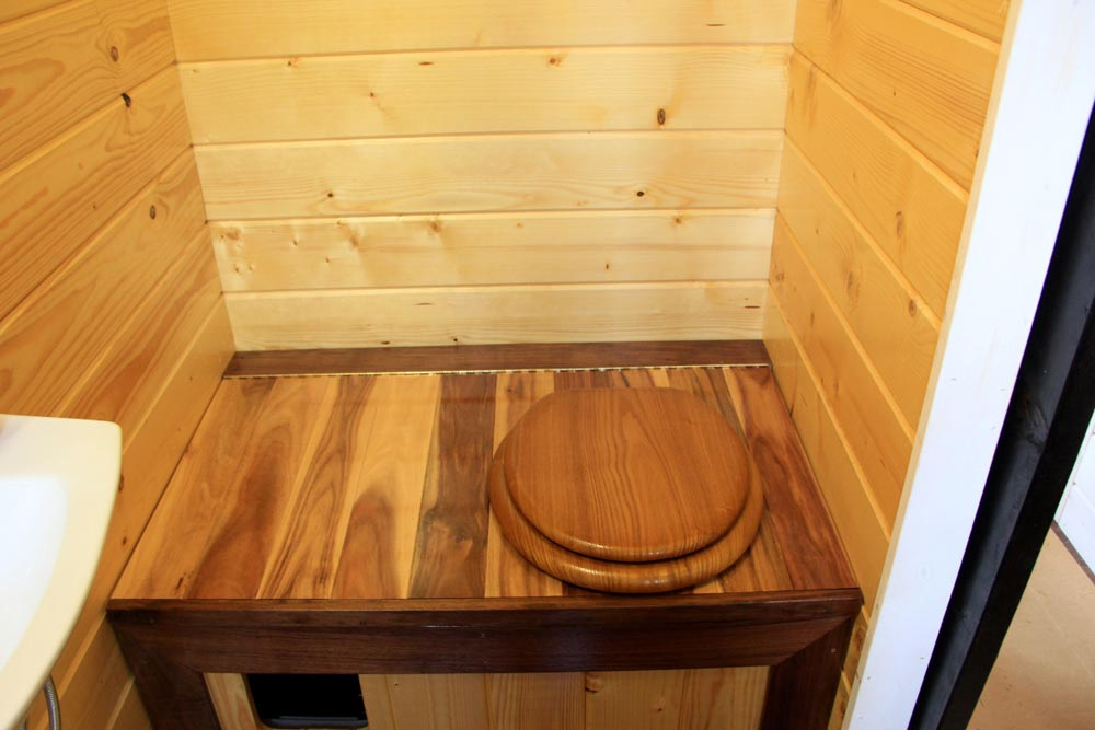 Composting toilet and kitty litter area - Fort Austin by Brevard Tiny House
