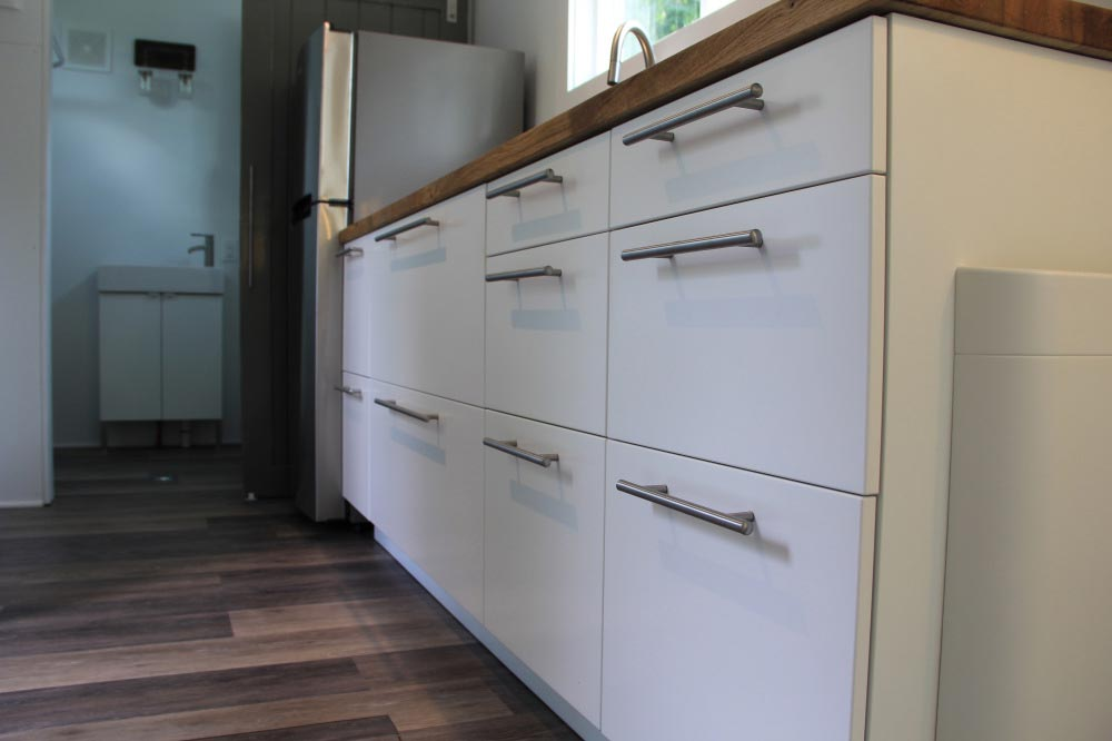 White kitchen cabinets detail - Every Tiny Moment by Brevard Tiny House