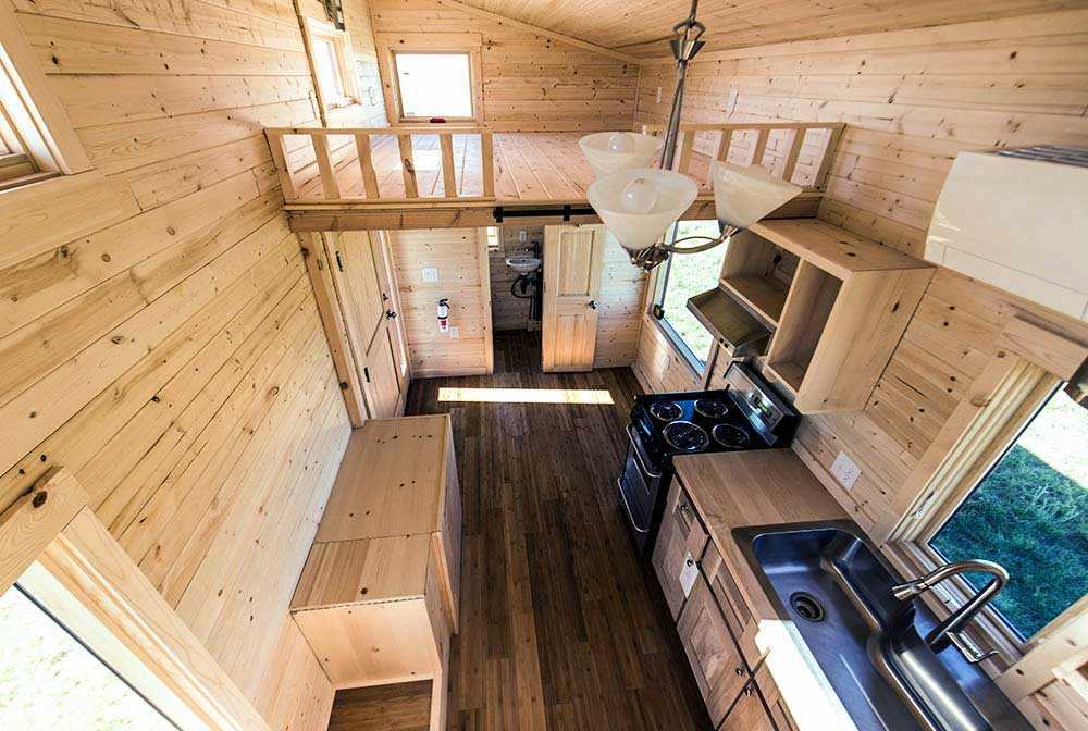 All wood interior give a cool cabin feel on the inside roanoke by tumbleweed tiny