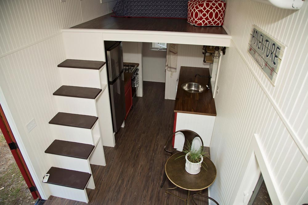 Storage stairs leading to king bed master loft - American Pie by Perch & Nest