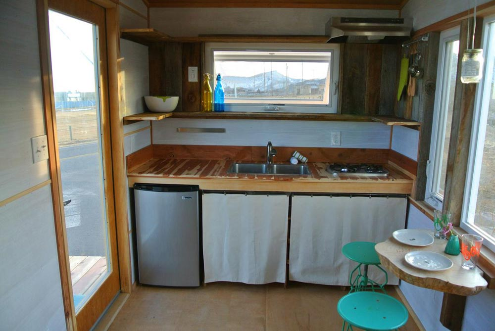 Kitchen with under-counter refrigerator - Boulder by Rocky Mountain Tiny Houses