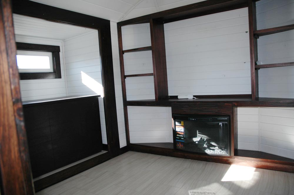 Living room with Murphy bed over gooseneck - Carpathian by Tiny Idahomes
