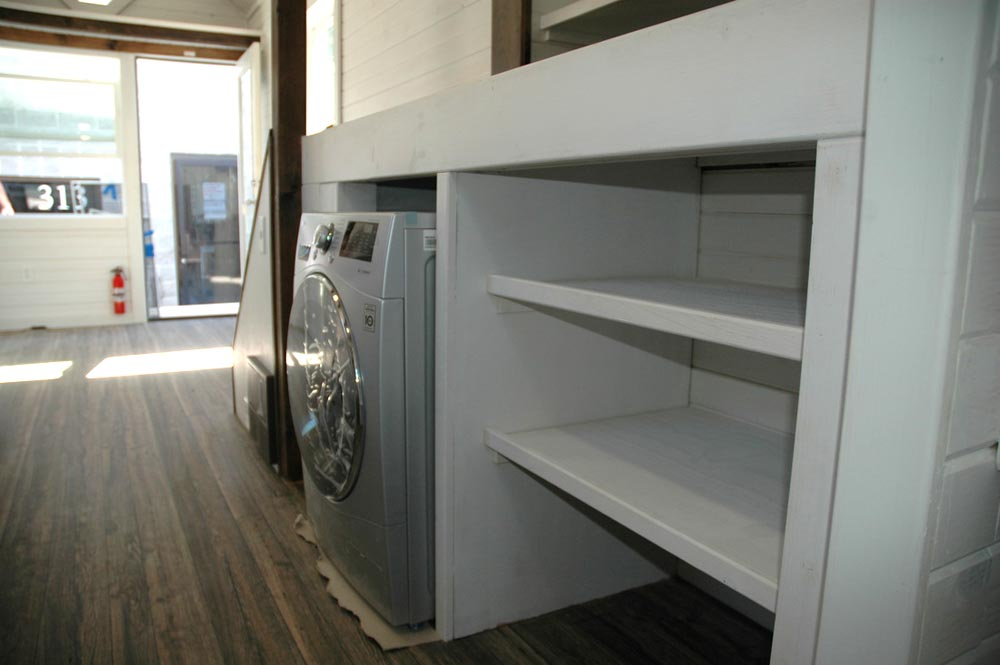 Washer/dryer and storage area - Clear Creek by Tiny Idahomes