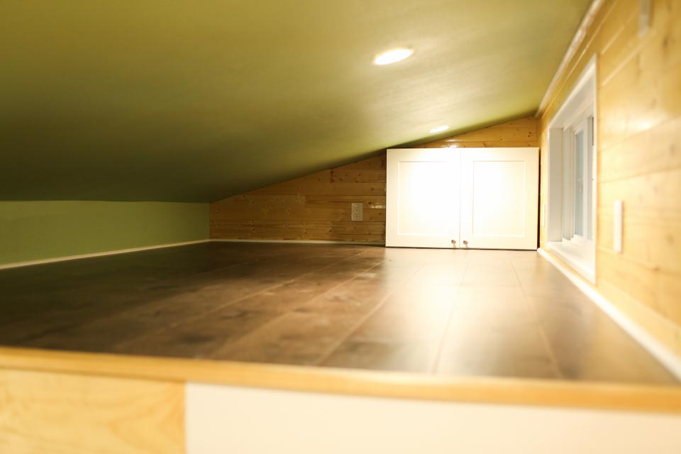 Bedroom loft with angle ceiling - Fontana by Cornerstone Tiny Homes