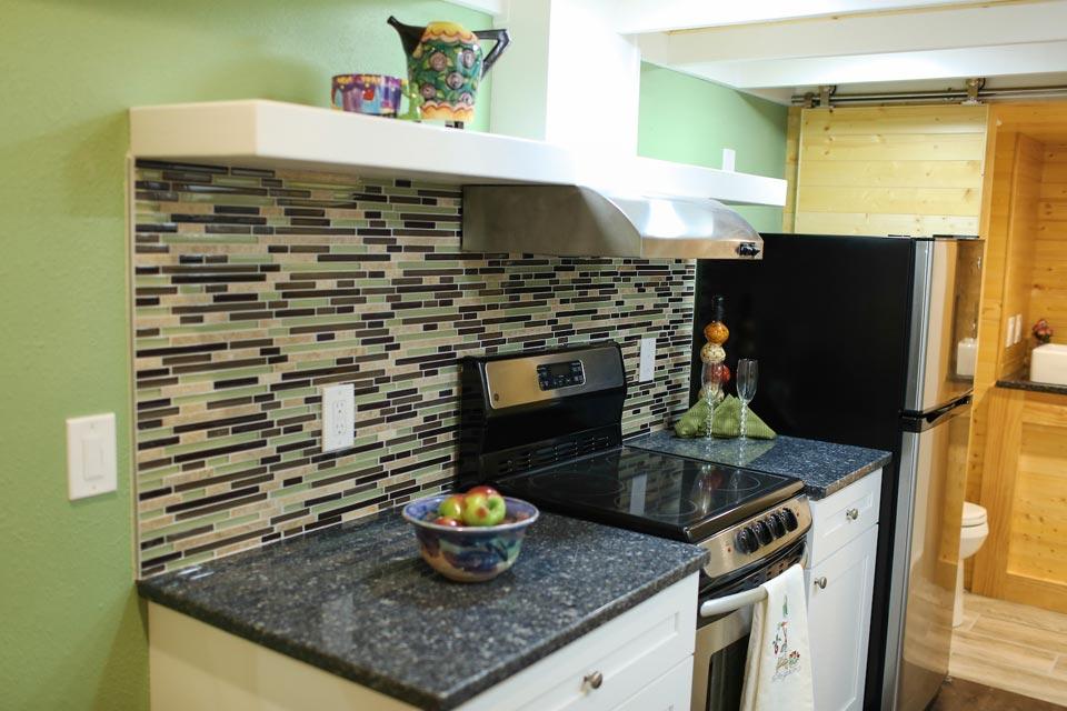 Granite countertops and electric range - Fontana by Cornerstone Tiny Homes