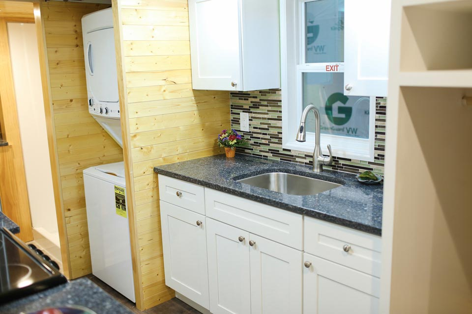 Kitchen and laundry area - Fontana by Cornerstone Tiny Homes