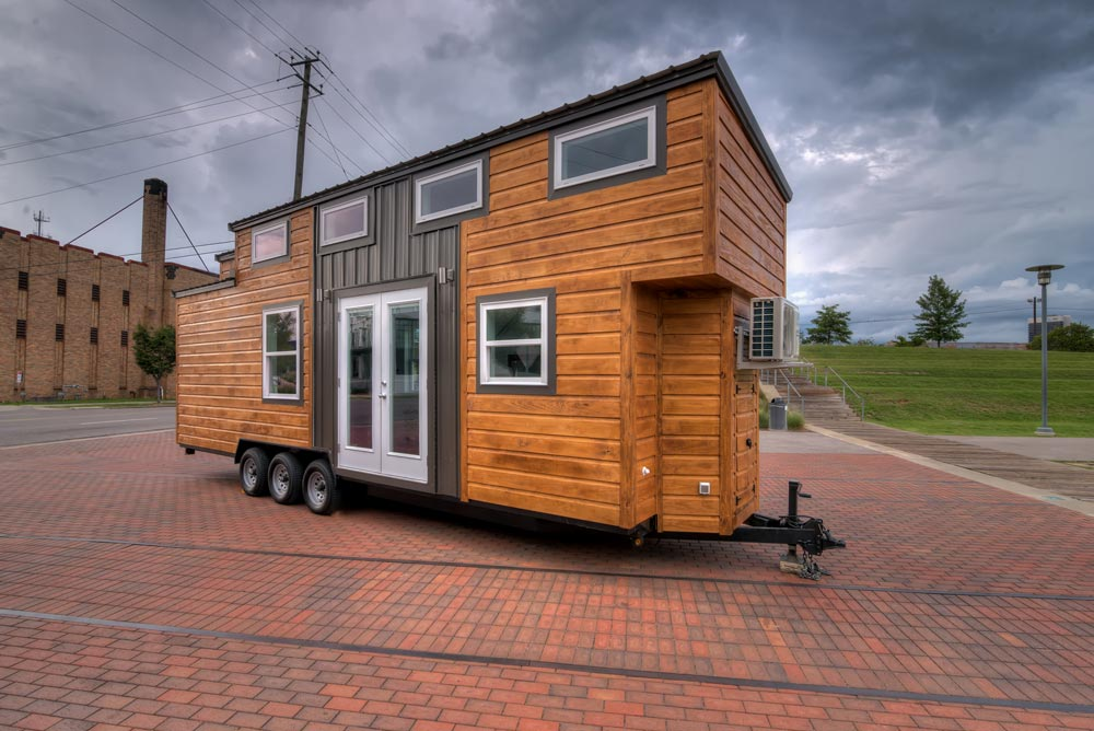 Triple axle tiny house on wheels - Freedom by Alabama Tiny Homes