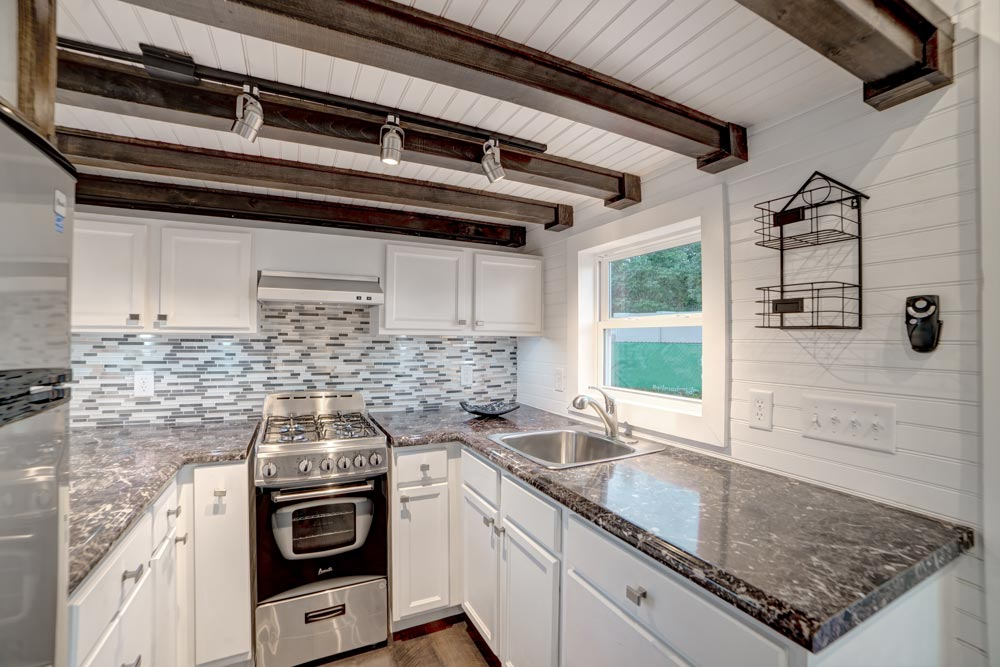 Kitchen with white cabinets - Freedom by Alabama Tiny Homes