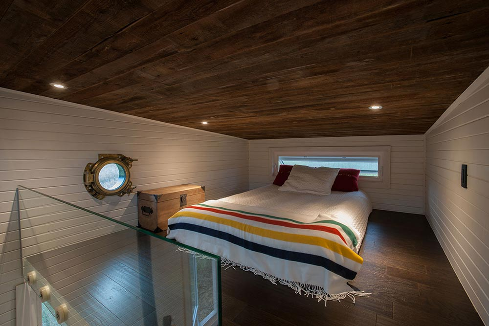 Bedroom loft with reclaimed barn wood ceilings - Greenmoxie Tiny House