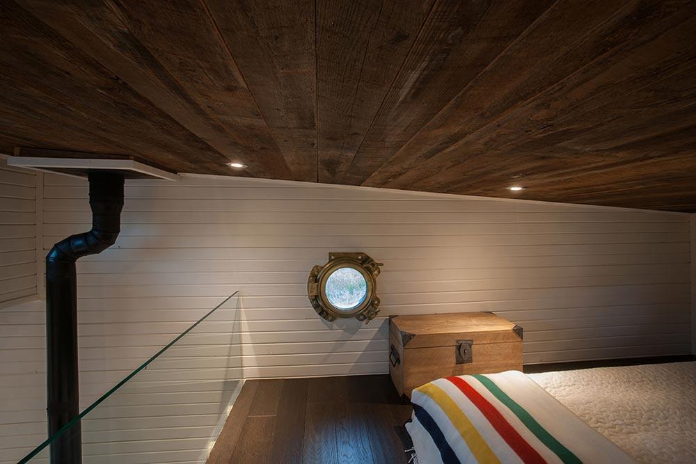 Reclaimed brass portal window - Greenmoxie Tiny House