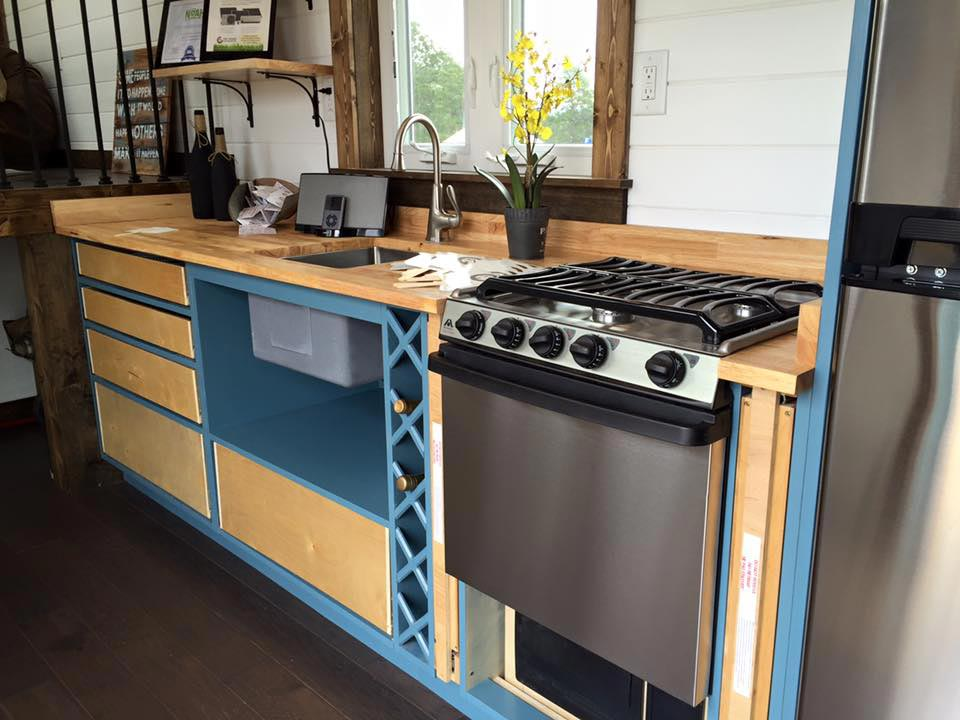 Kitchen with propane stove - Lookout by Tiny House Chattanooga