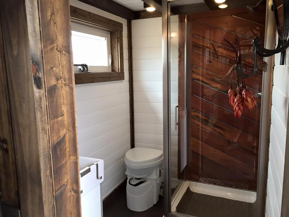 bathroom with tiger wood shower lookout by tiny house chattanooga