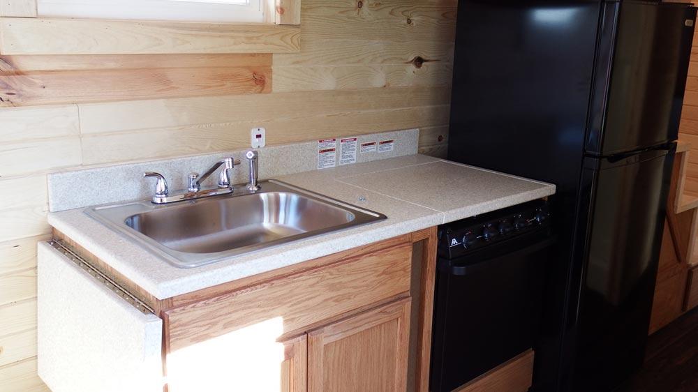 Kitchen with Corian countertops - Murphy by Tiny Idahomes