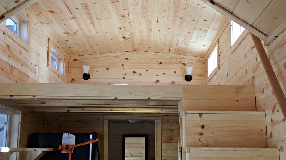 Storage stairs leading to bedroom loft - Phoenix by Tiny Idahomes