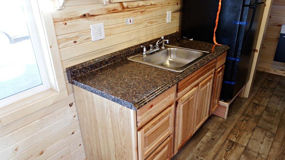 Laminate countertops and natural Hickory cabinets - Phoenix by Tiny Idahomes