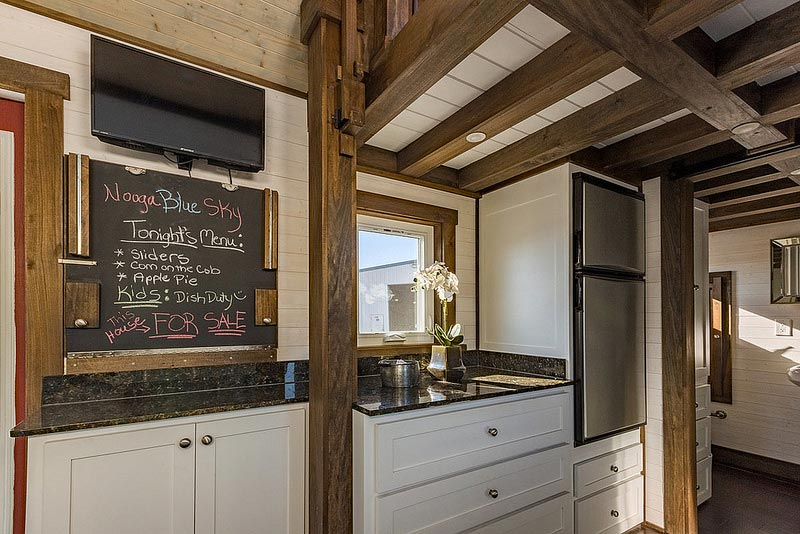 Kitchen with box beam ceiling - Nooga Blue Sky by Tiny House Chattanooga