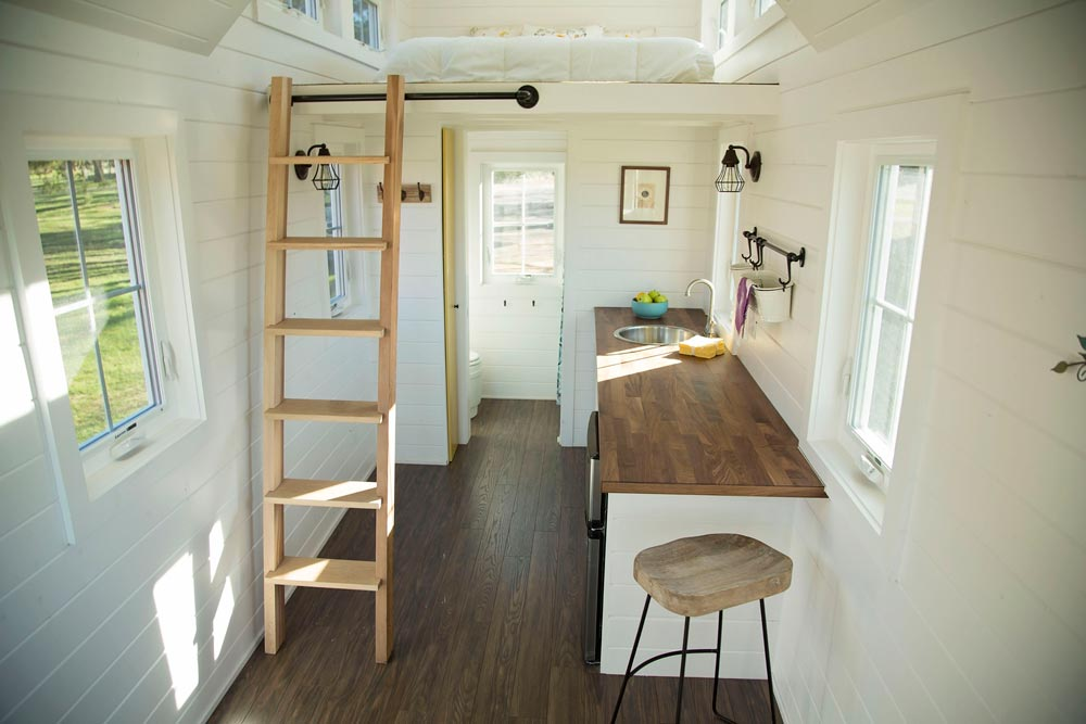 Kitchen and ladder to bedroom loft - Pecan by Perch & Nest