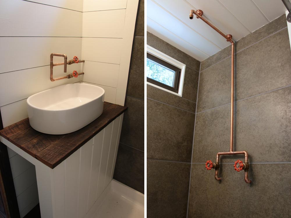 Concrete shower tiles and exposed copper pipes - Wind River Tiny Homes
