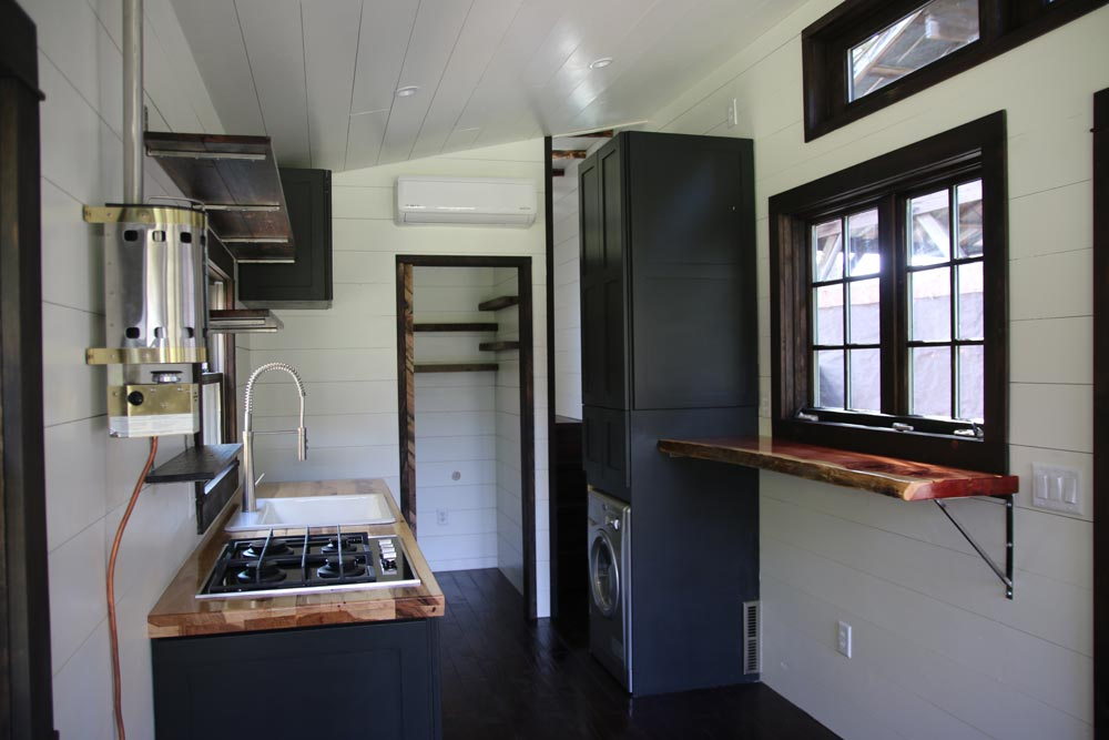 Kitchen with washer/dryer combo - Wind River Tiny Homes