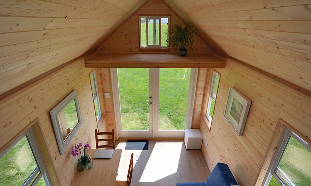 Living room with storage loft overhead - Poco Edition by Mint Tiny Homes