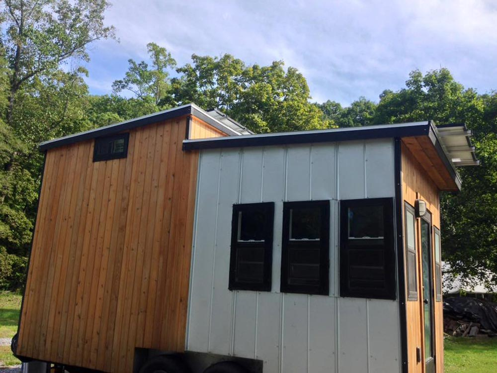 Cedar exterior with aluminum accents - Tiny Solar House