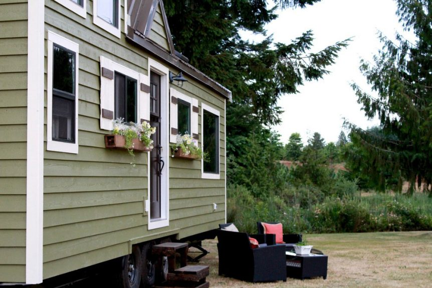 Green siding with white trim on this Vintage model by Tiny Heirloom