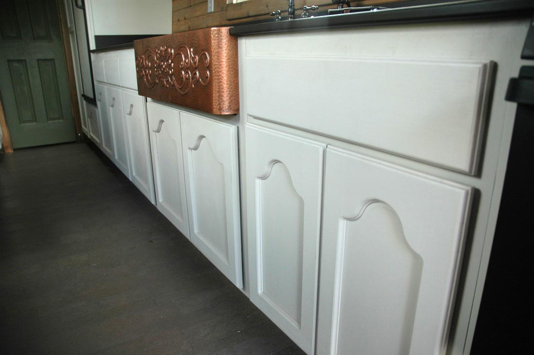 Custom cabinets and copper farm sink - Zamora Vardo by Tiny Idahomes
