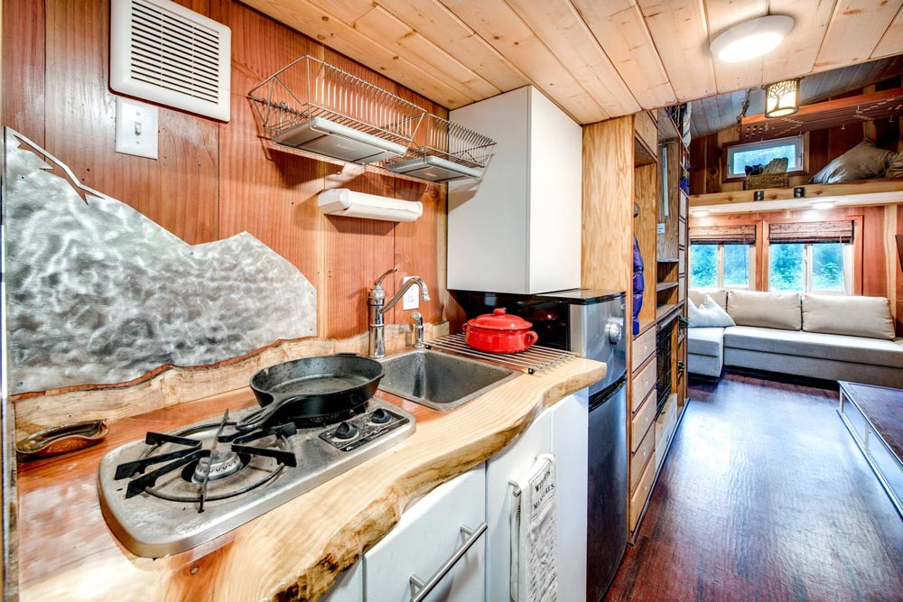 Kitchen w/ Two Burner Cooktop - Basecamp by Backcountry Tiny Homes