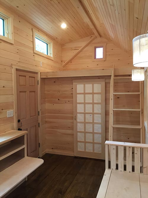Barn door to bathroom - Brownie by Liberation Tiny Homes