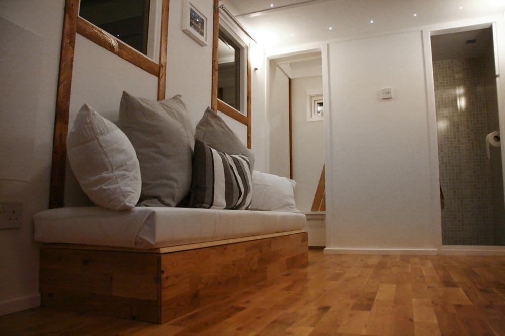 Couch with storage - Tiny House UK by Mark Burton