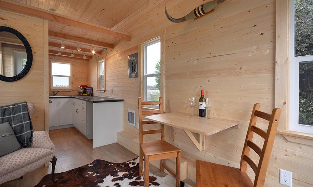Dining and kitchen areas - Cabin in the Woods by Mint Tiny Homes