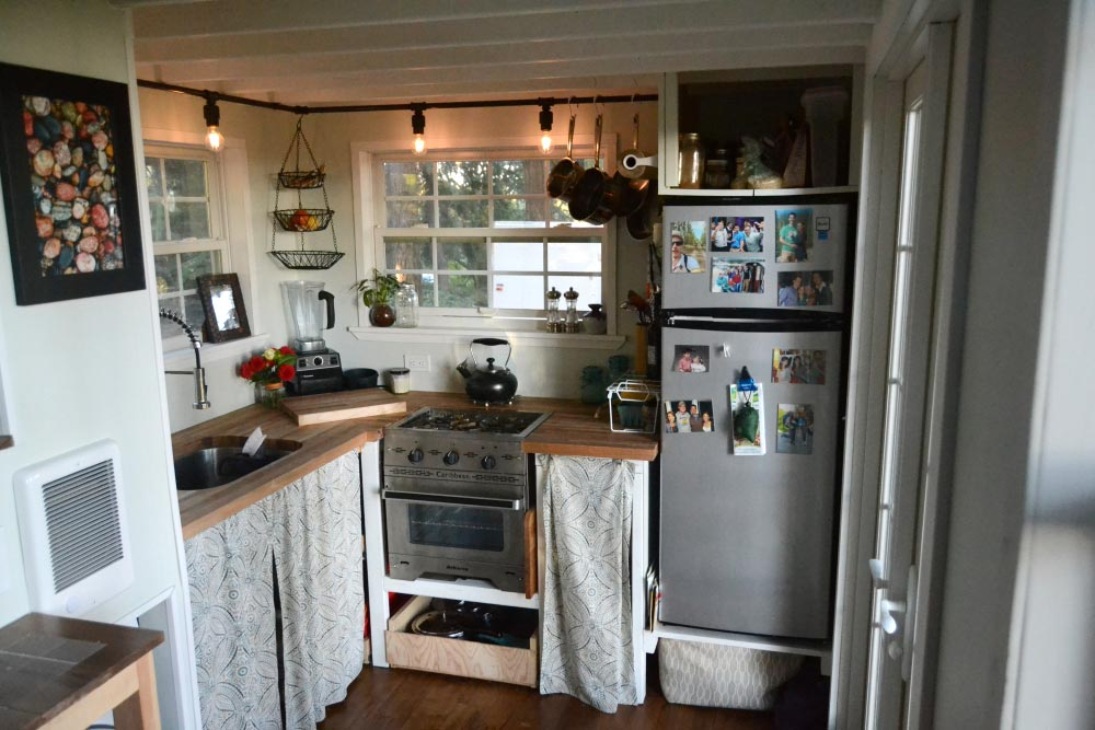 Kitchen w/ Stove & Refrigerator - Tiny House by Liz & Tyler Cragg