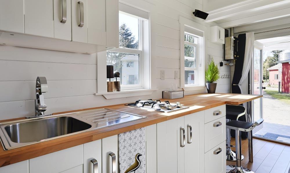Kitchen w/ 2 Burner Cooktop - Custom Tiny by Mint Tiny Homes