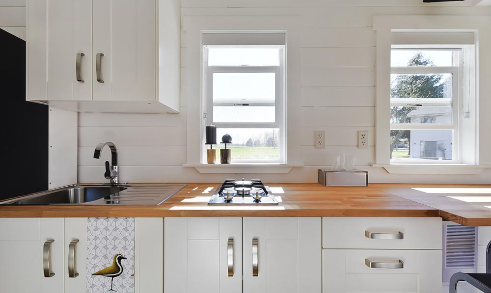 Kitchen Cabinets & Window - Custom Tiny by Mint Tiny Homes