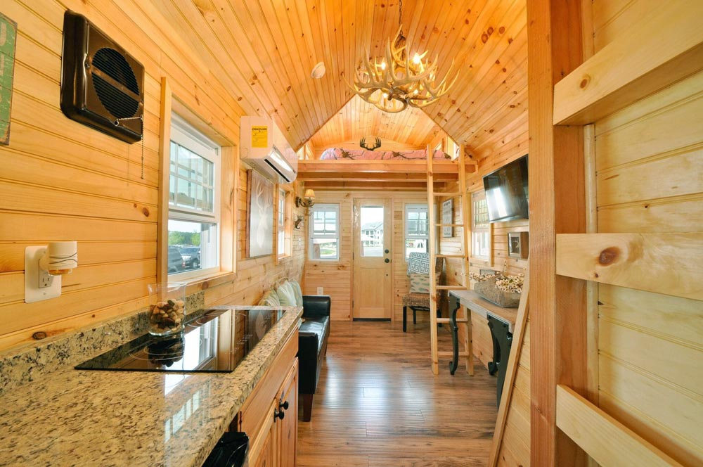 Kitchen with induction cooktop - Mountaineer by Tiny House Building Company