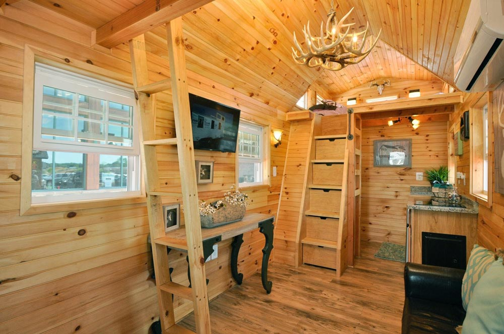 Storage stairs and ladder to bedroom lofts - Mountaineer by Tiny House Building Company