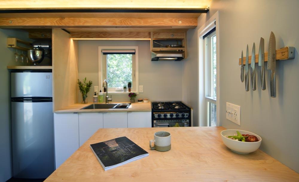 Kitchen with peninsula - SHEDsistence Tiny House