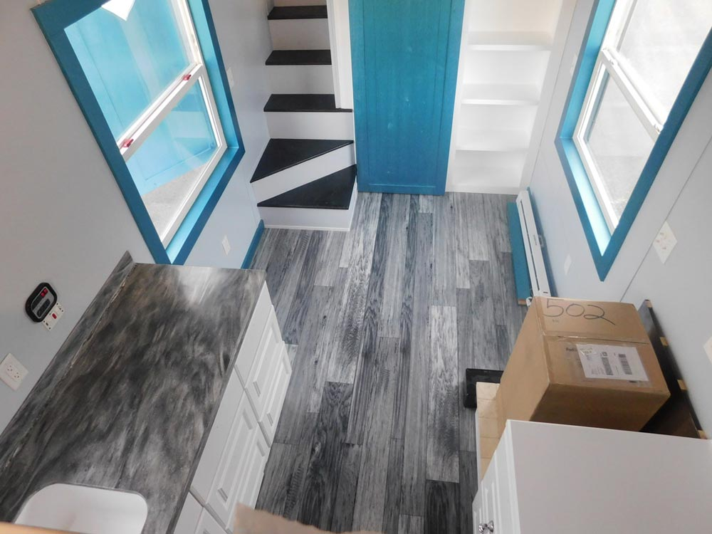 Matching Flooring and Countertop Colors - French Storyteller by Tiny Idahomes
