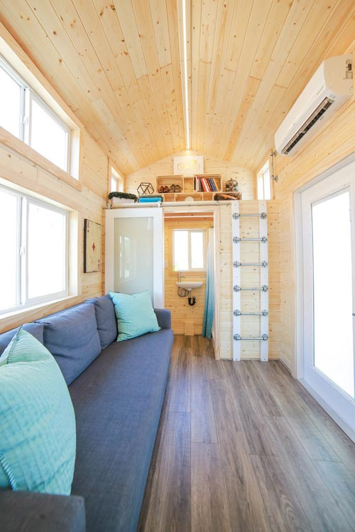 Living Room & Storage Loft - Mansion Jr by Uncharted Tiny Homes