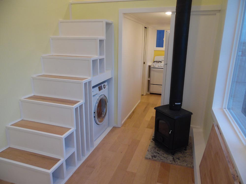 Storage Stairs & Wood Stove - 30' Off Grid by Upper Valley Tiny Homes