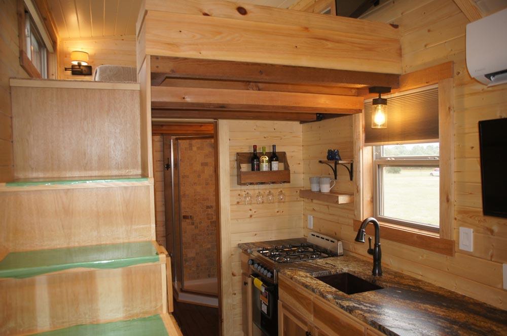 Kitchen & Stairs - Prairie Schooner by Wander Homes