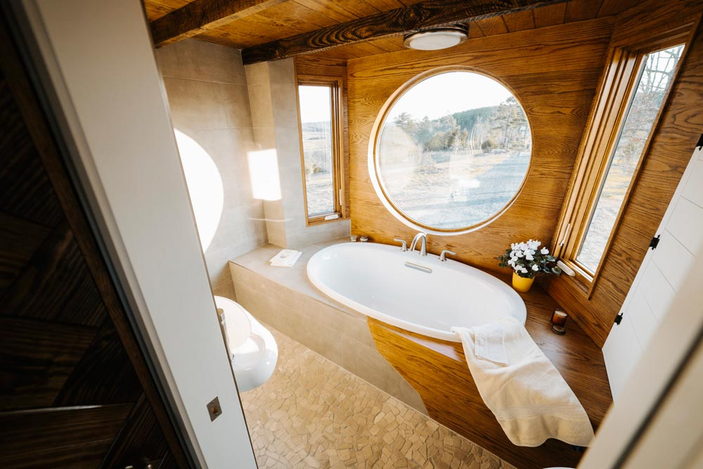 Soaking Tub with Tile/Oak Surround - Monocle by Wind River Tiny Homes