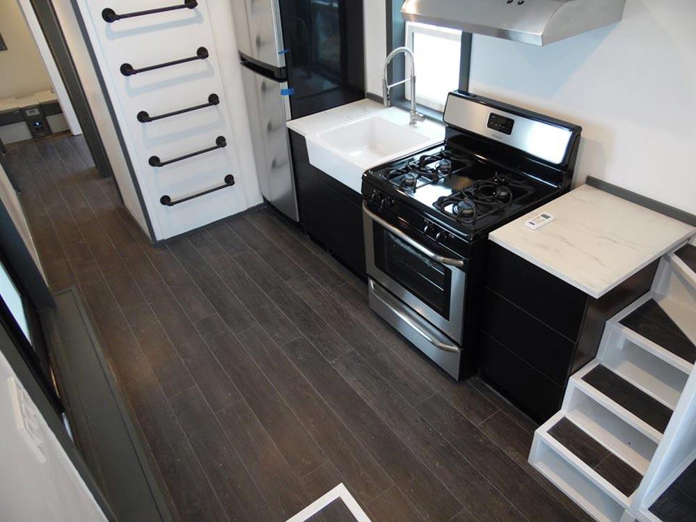 Dark Laminate Flooring - Barn Style by Upper Valley Tiny Homes