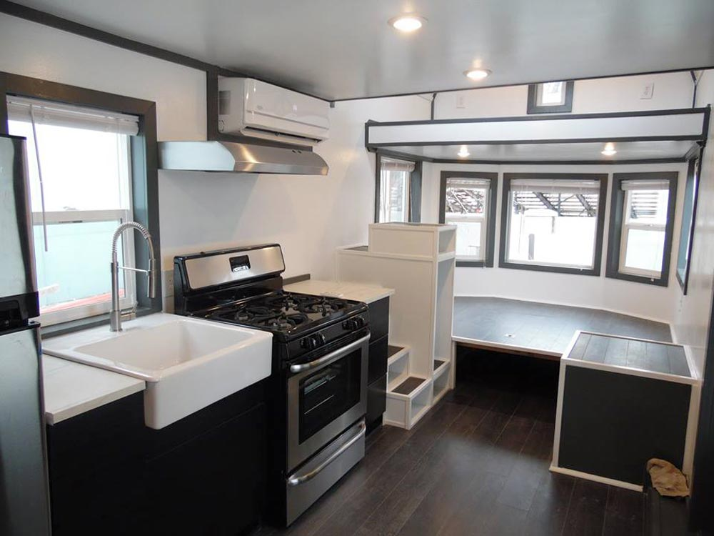 Kitchen & Raised Platform - Barn Style by Upper Valley Tiny Homes